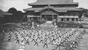 Students practicing Karate outside Shuri Castle in Okinawa (c. 1938)